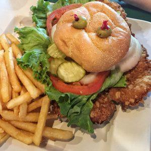 Fried pork tenderloin sandwich with fries
