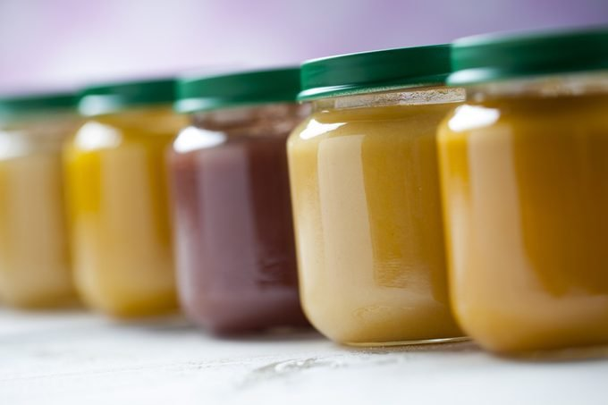 healthy ready-made baby food in jars on a wooden table