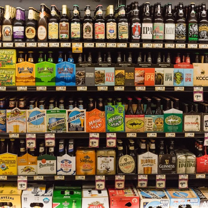 HOSTON,US-JUN 25,2016:Various bottles of craft, microbrews, IPAs, domestic and imported beer beers from around the world on shelf display in supermarket.Alcohol drinks background, different beer style; Shutterstock ID 446130109