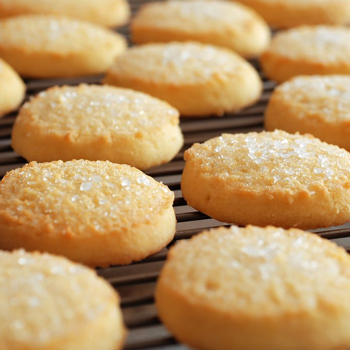 Freshly baked sugar cookies on cooling rack. Closeup with extremely shallow dof. ; Shutterstock ID 153370979; Job (TFH, TOH, RD, BNB, CWM, CM): Taste of Home