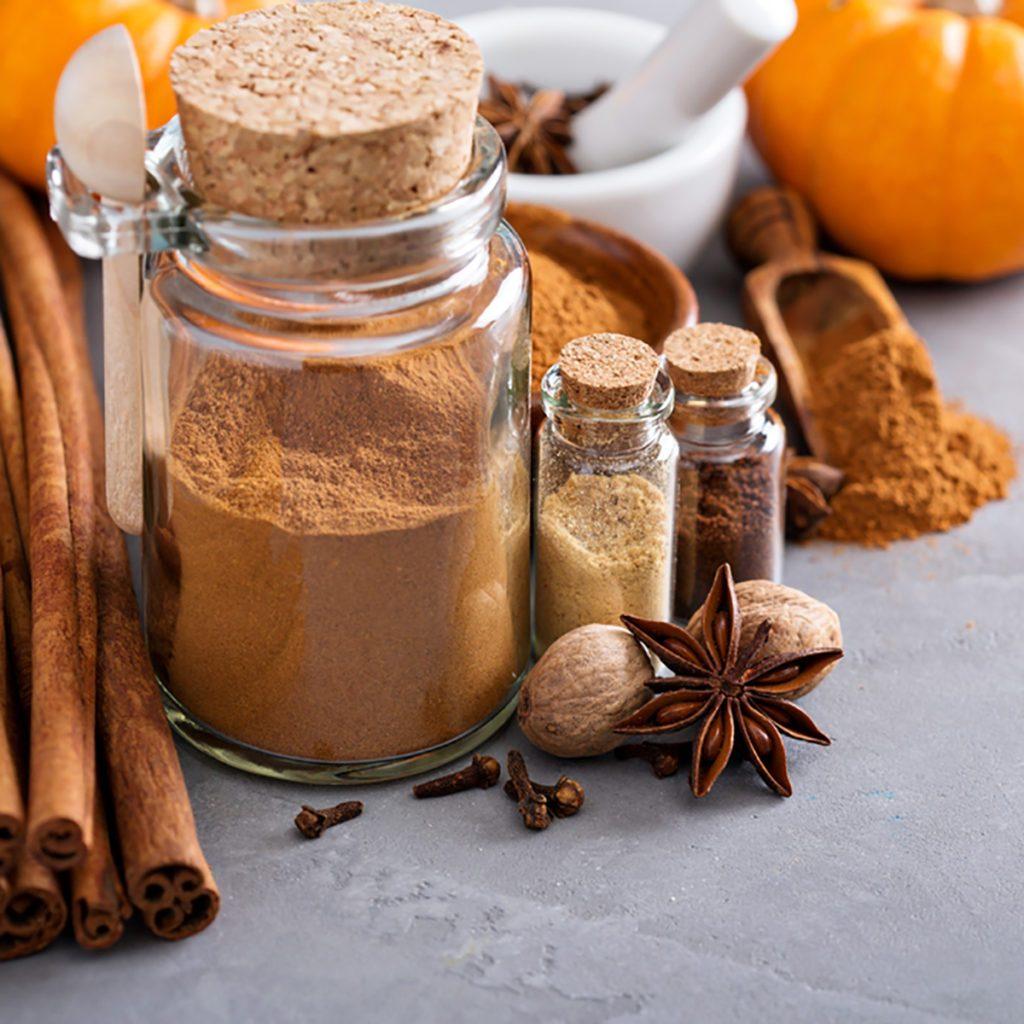 Homemade pumpkin pie spice in a glass jar with ingredients; Shutterstock ID 461456947