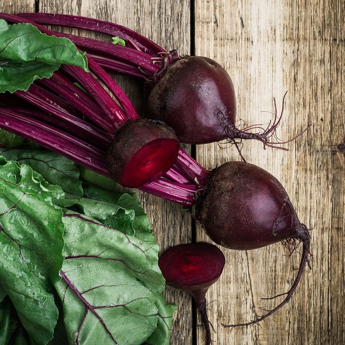 Fresh organic beetroot over wooden background viewed from above