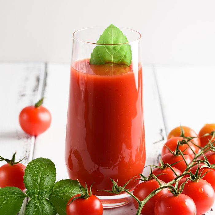 Tomato juice in a glass with a cherry and basil on a light background; Shutterstock ID 1011529984; Job (TFH, TOH, RD, BNB, CWM, CM): TOH