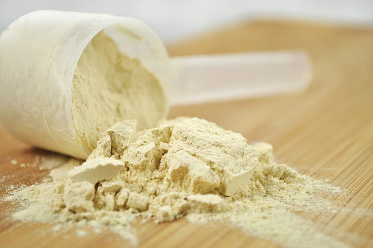 Protein powder or weight loss powder spilling out of a measuring scoop