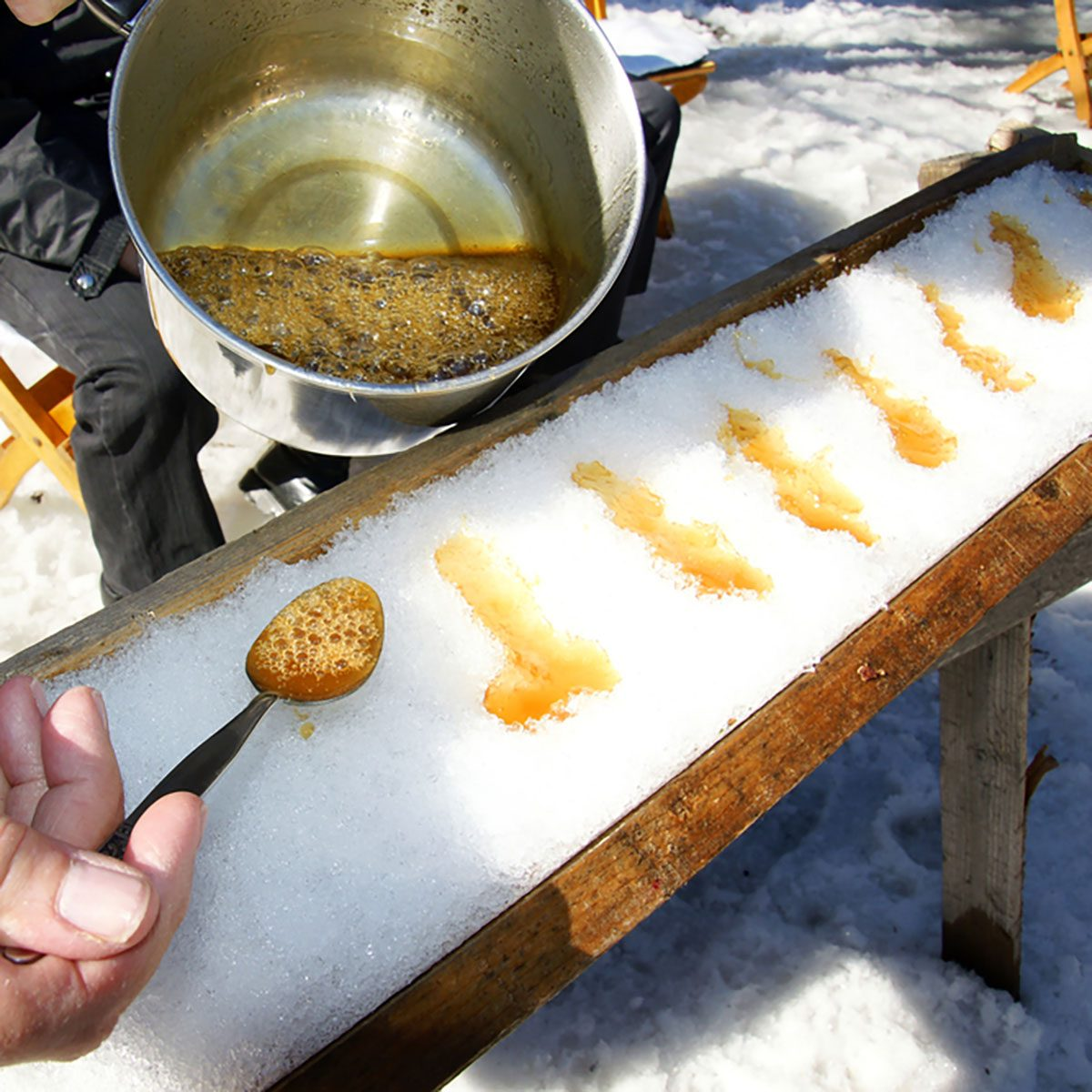 Making sugar on snow, or maple toffee at the sugar shack in Quebec, Canada