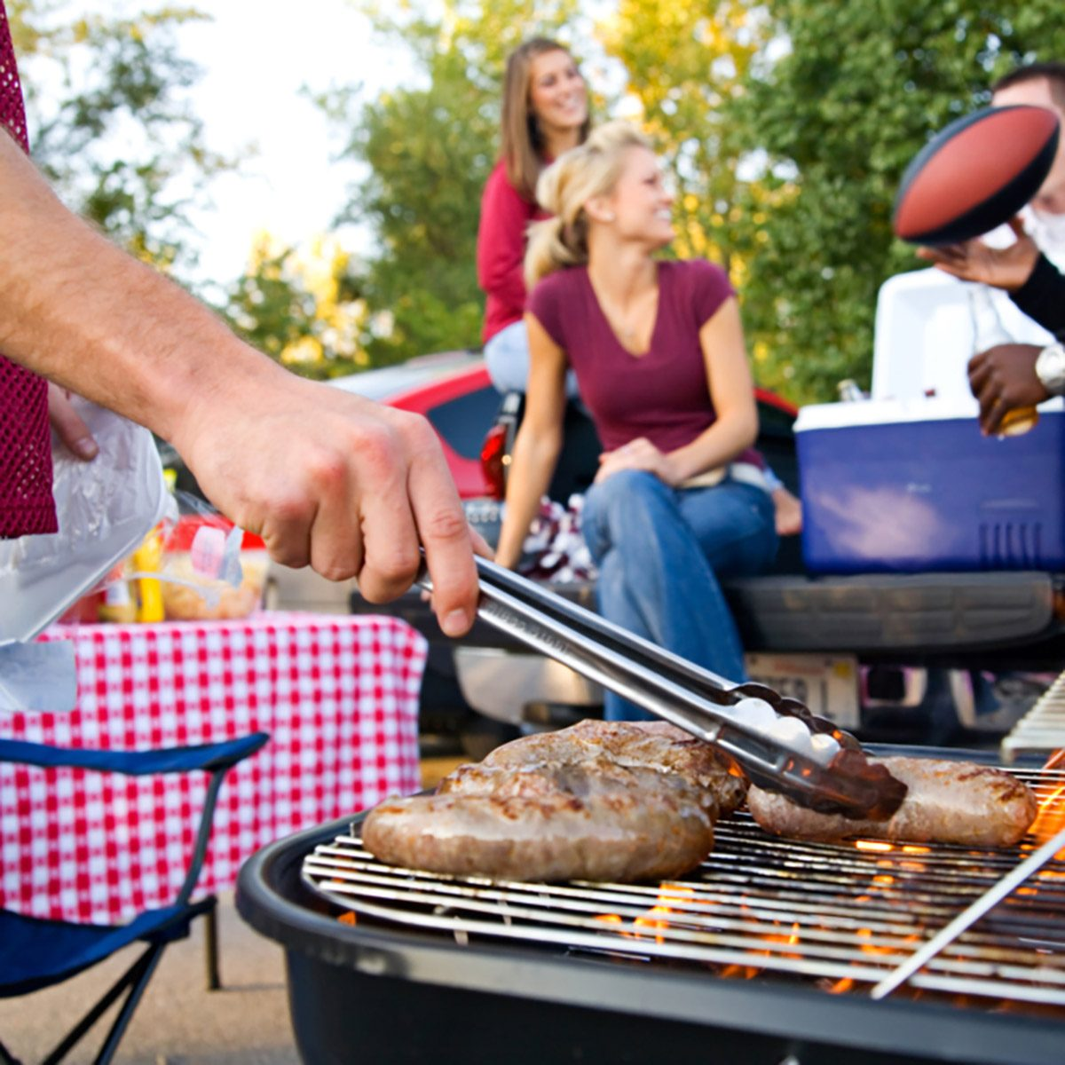 Tailgating: Bratwurst Cooking On Grill For Tailgate Party