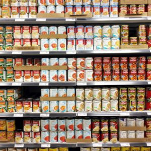 Canned food products in a supermarket. Canned foods consumption has declined in North America as the economy improves and consumers spending more on fresher food items.