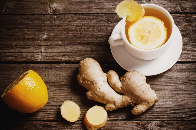 Ginger tea with lemon in a white cup