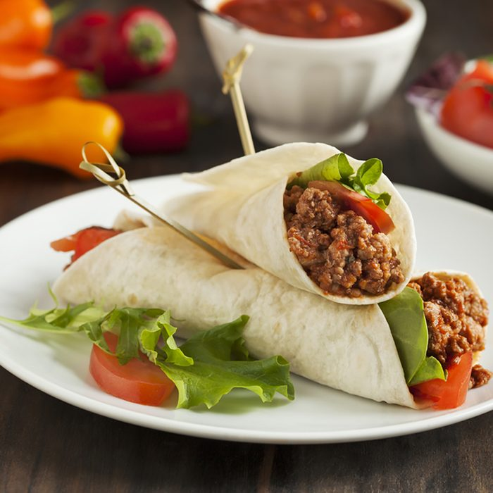 Burritos filled with meat and vegetables.