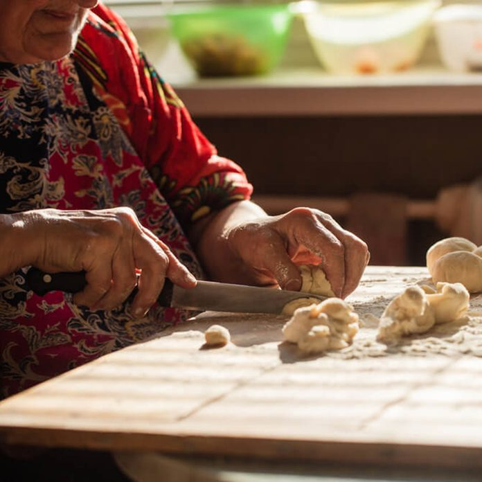 Senior woman chopping veggies