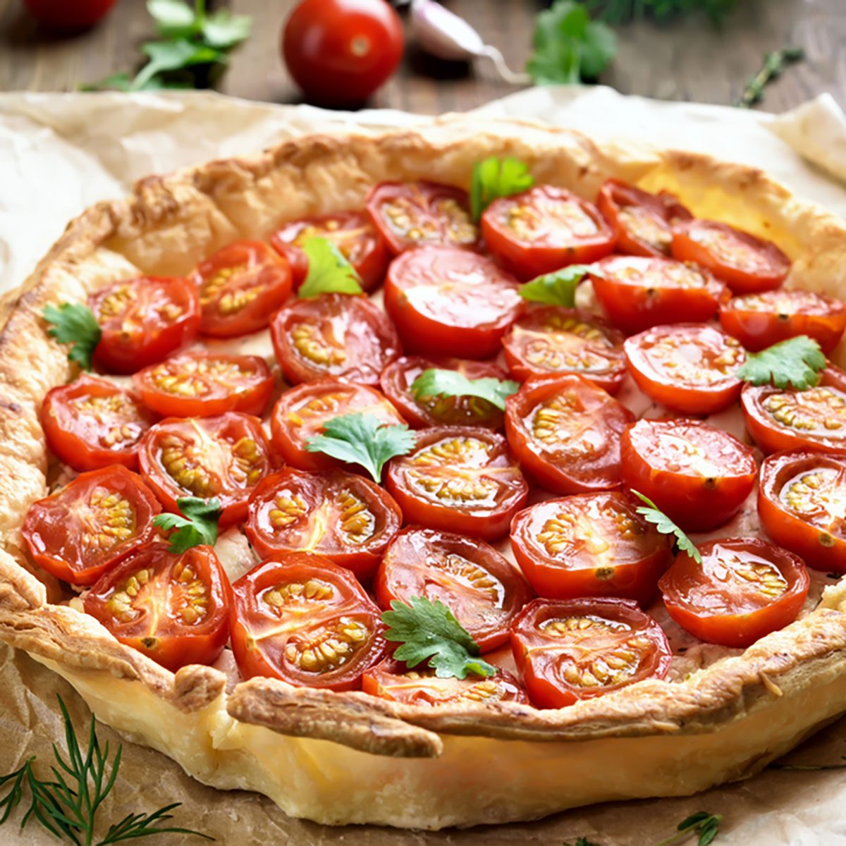 Tomato pie on baking paper, close up view