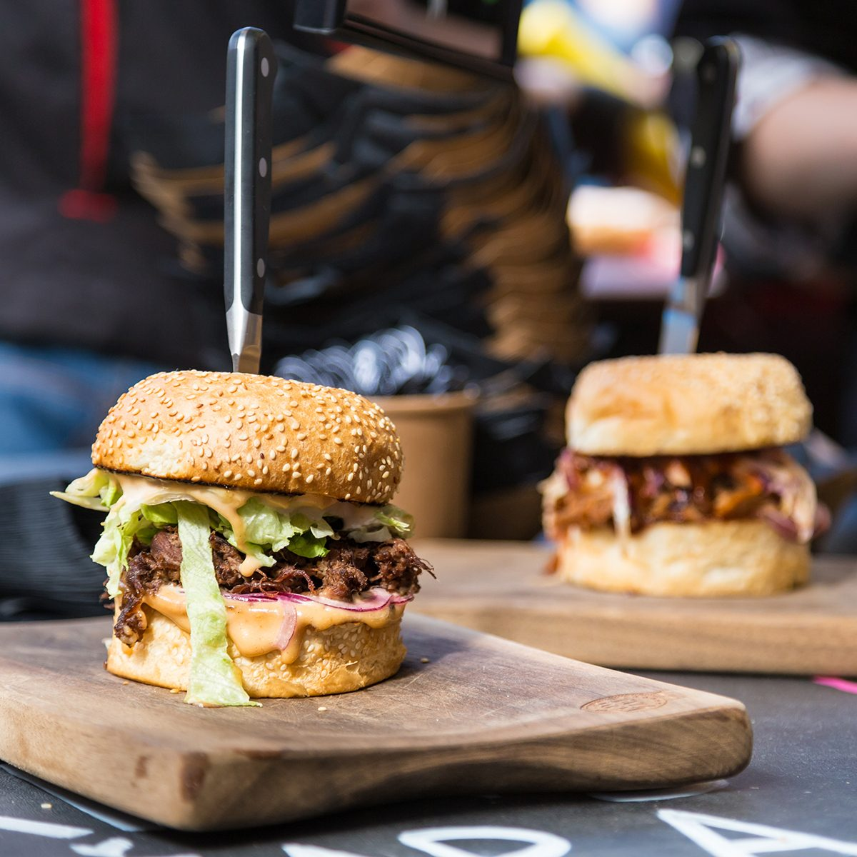 Burgers artfully presented on boards