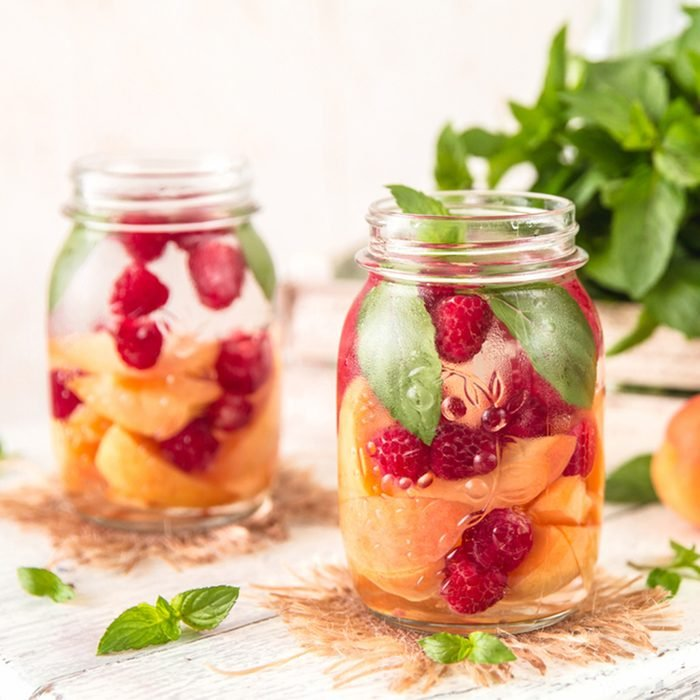 Cold Fruit Infused Detox Water with apricots raspberries and mint
