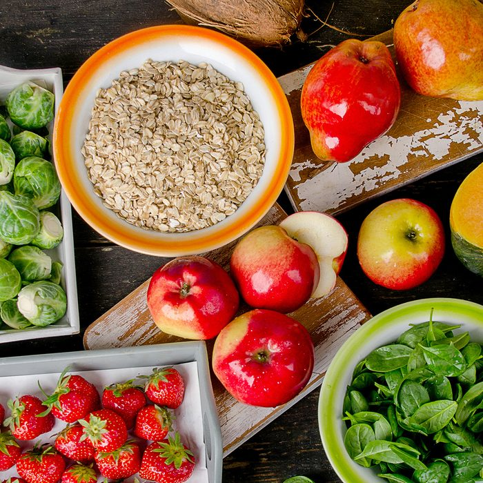 high fiber foods like apples, strawberries, oatmeal, pears, spinach and Brussels sprouts