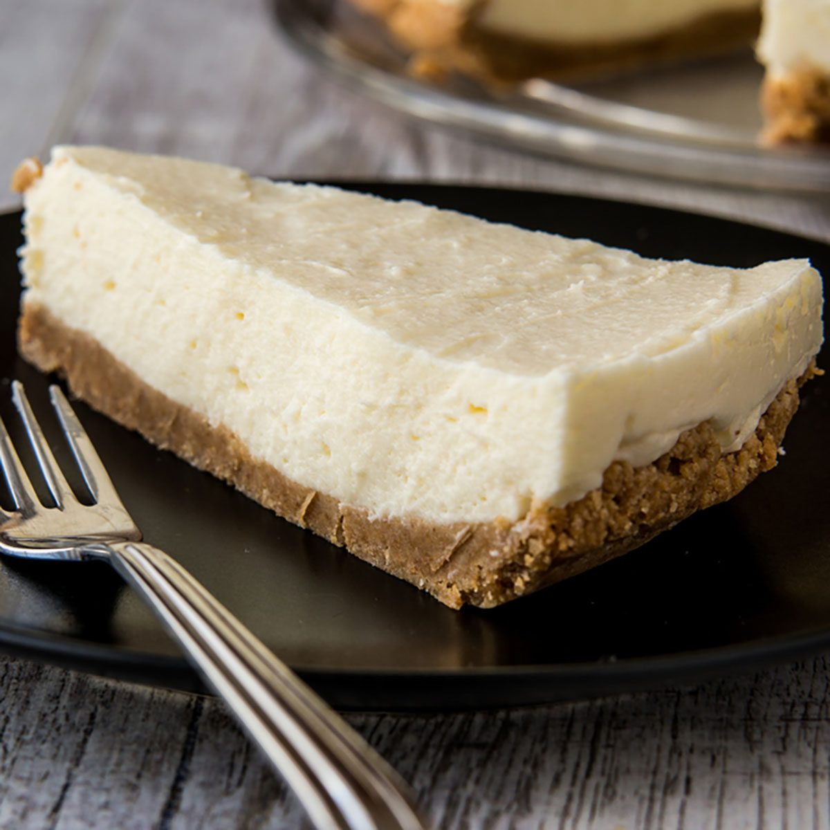Homemade New York Cheesecake with fork
