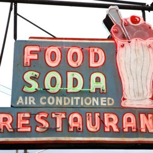 Original neon sign for a fast casual restaurant in Nashville that features ice cream sodas.;