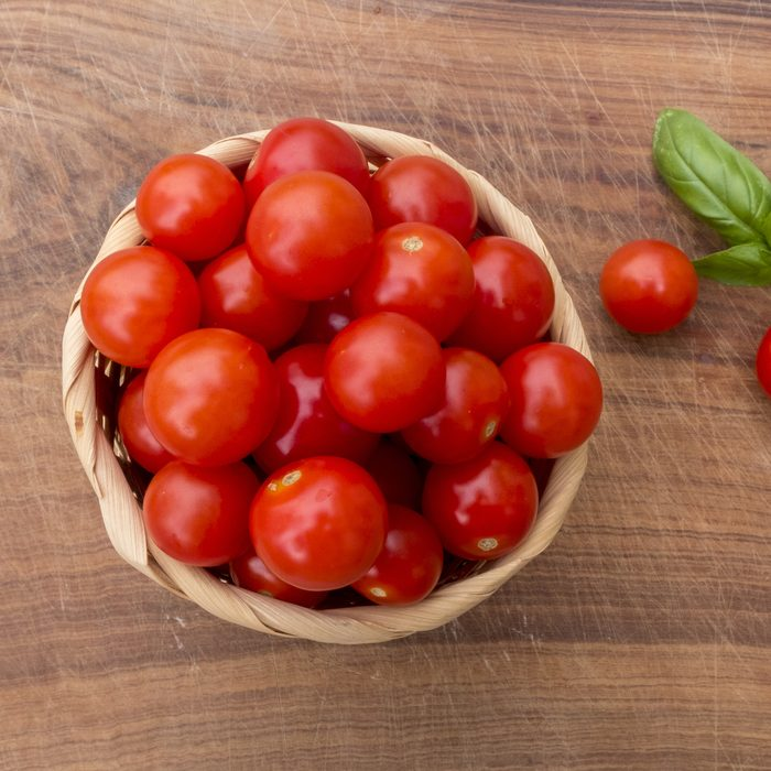wicker basket of cherry tomatoes