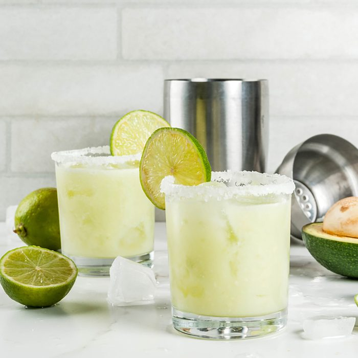 Alcoholic cocktail recipes and ideas. Avocado and lime margarita with salt, on a white marble kitchen table. Copy space; Shutterstock ID 735617161; Job (TFH, TOH, RD, BNB, CWM, CM): TOH
