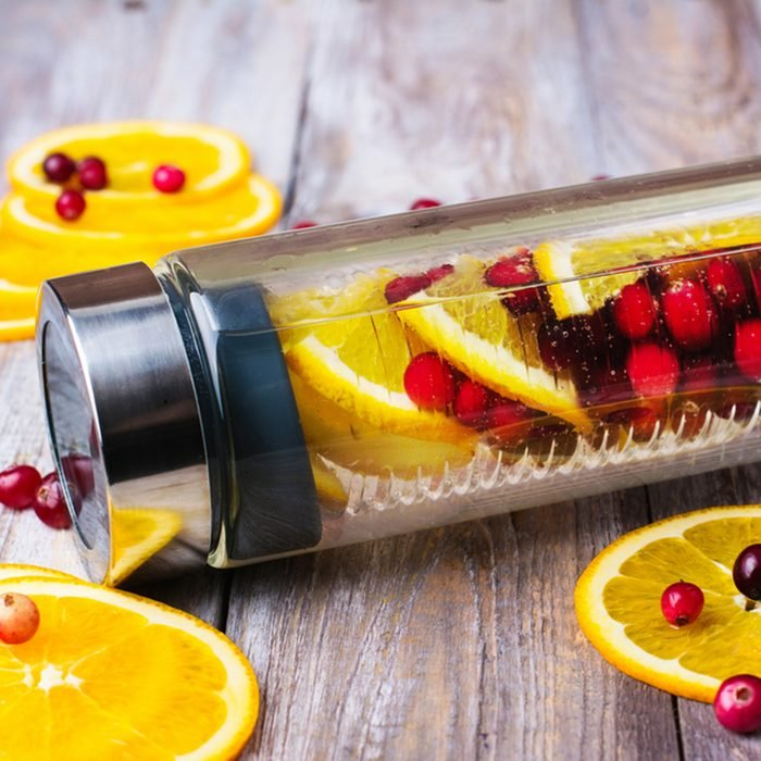 Summer refreshing detox infused water with cranberry and oranges
