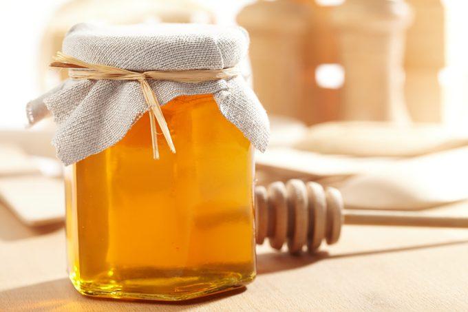 Honey with wood stick.