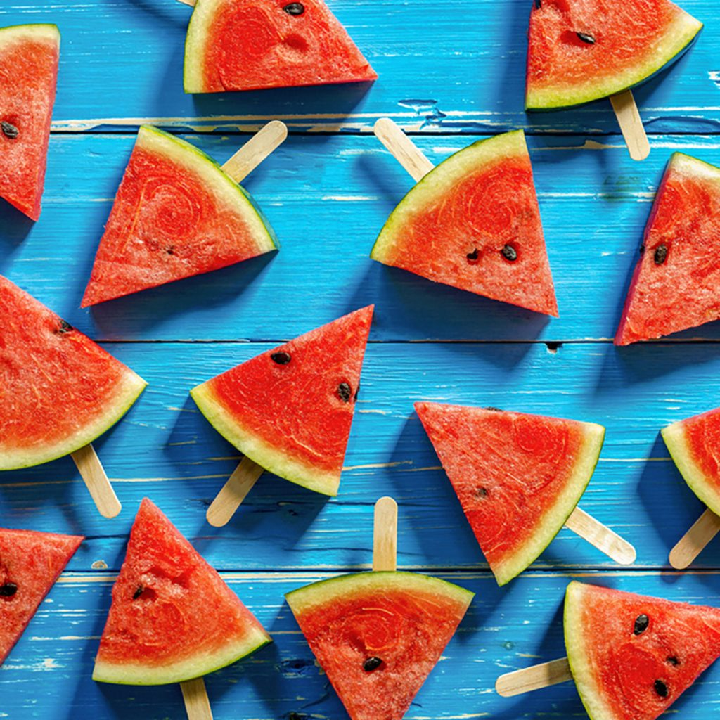 Watermelon slice popsicles on a blue rustic wood background; Shutterstock ID 439368238; Job (TFH, TOH, RD, BNB, CWM, CM): Taste of Home