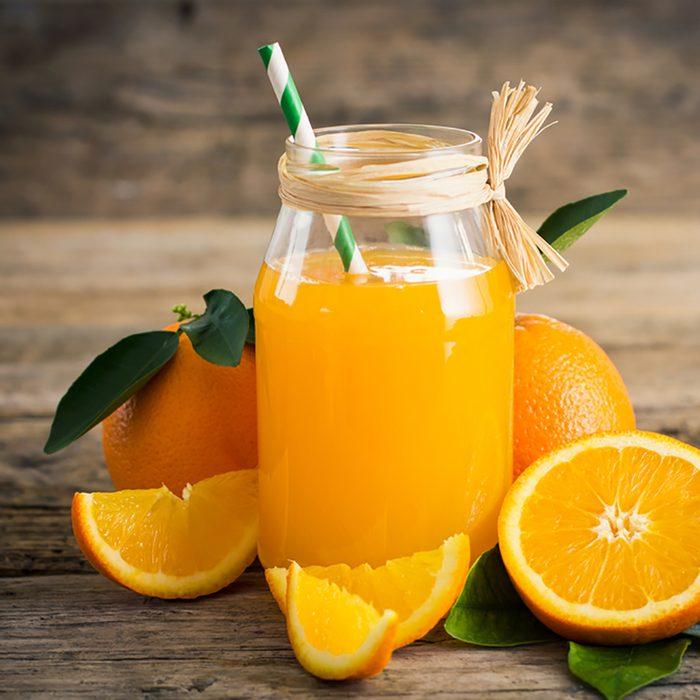 Fresh orange juice in the glass jar; Shutterstock ID 547801399