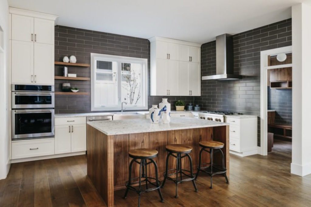 grey and white kitchen with marble island