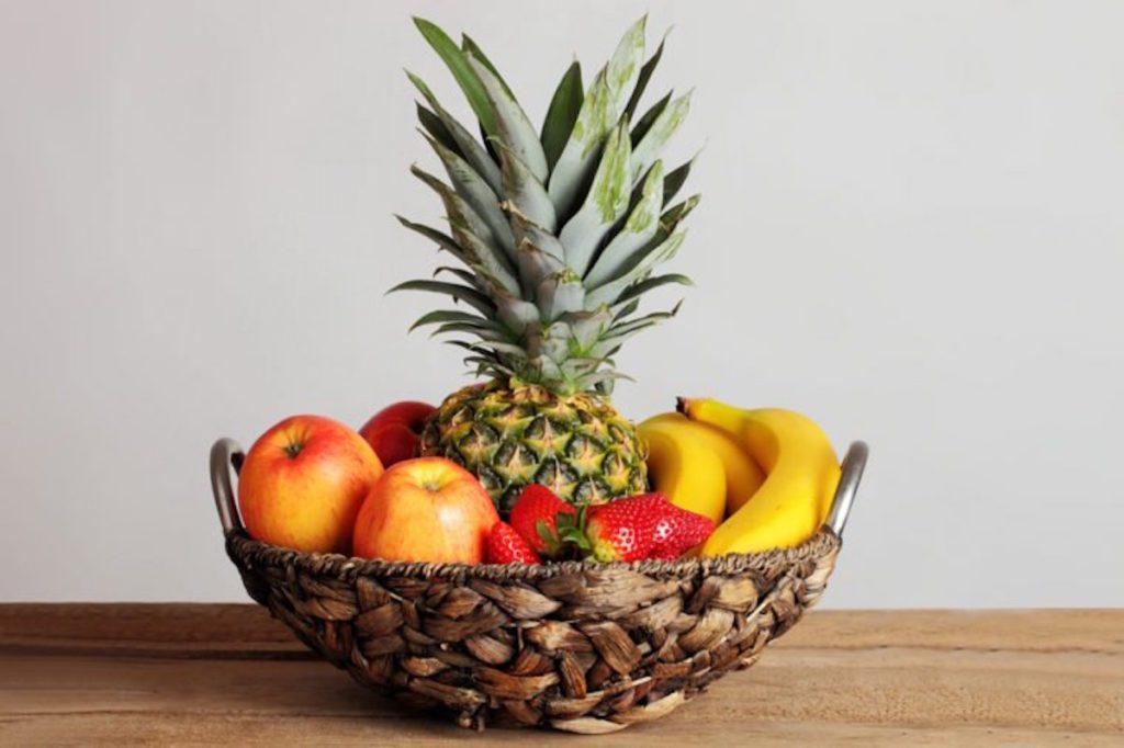 bowl of fruit in wicker basket