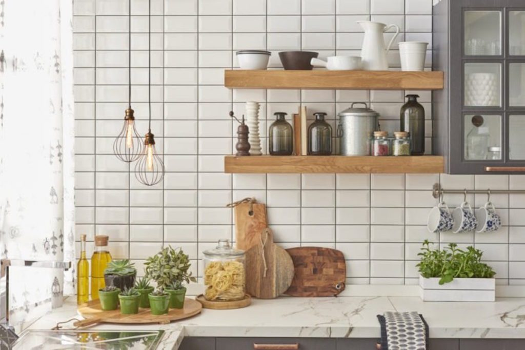 kitchen counter with wood shelves and white backsplash