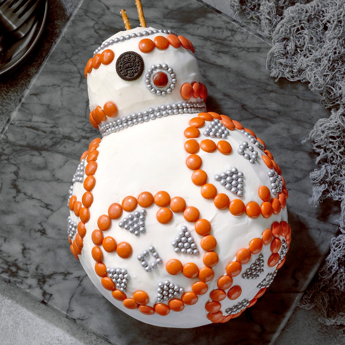 BB-8 Cake; overhead camera angle; Gray surface; gray cutting board; cake; star wars; May the 4th be with you; dessert; cake