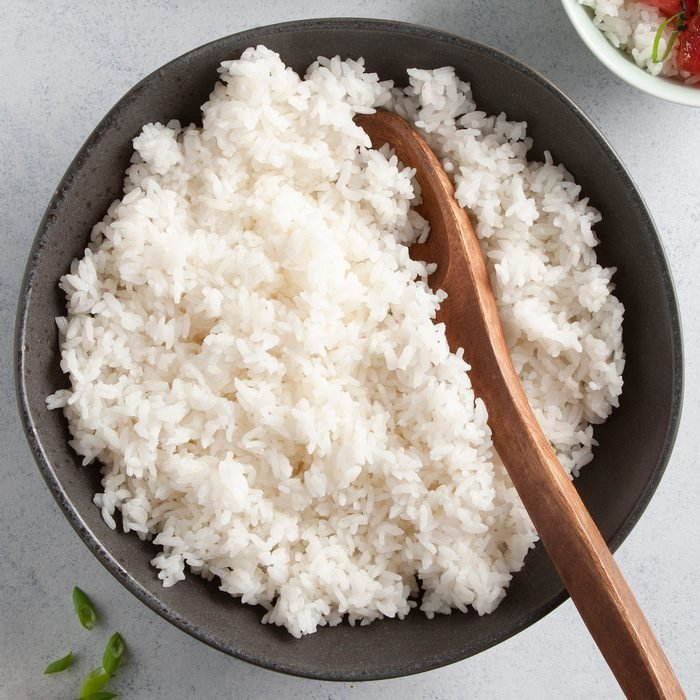 A bowl of fluffy, white cooked rice.