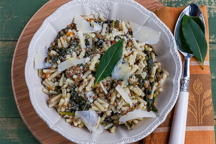 Penne pasta with lentils and kale