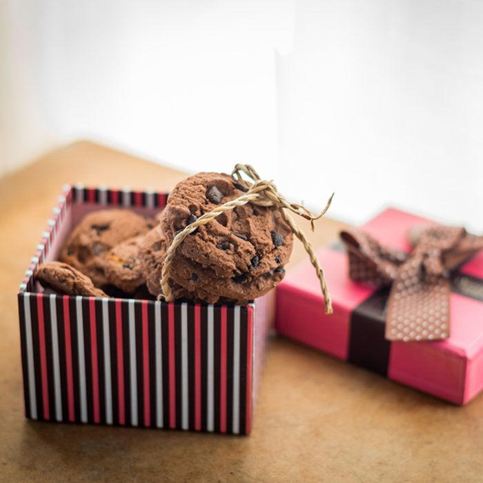 Chocolate cookies and Gift box on wood table