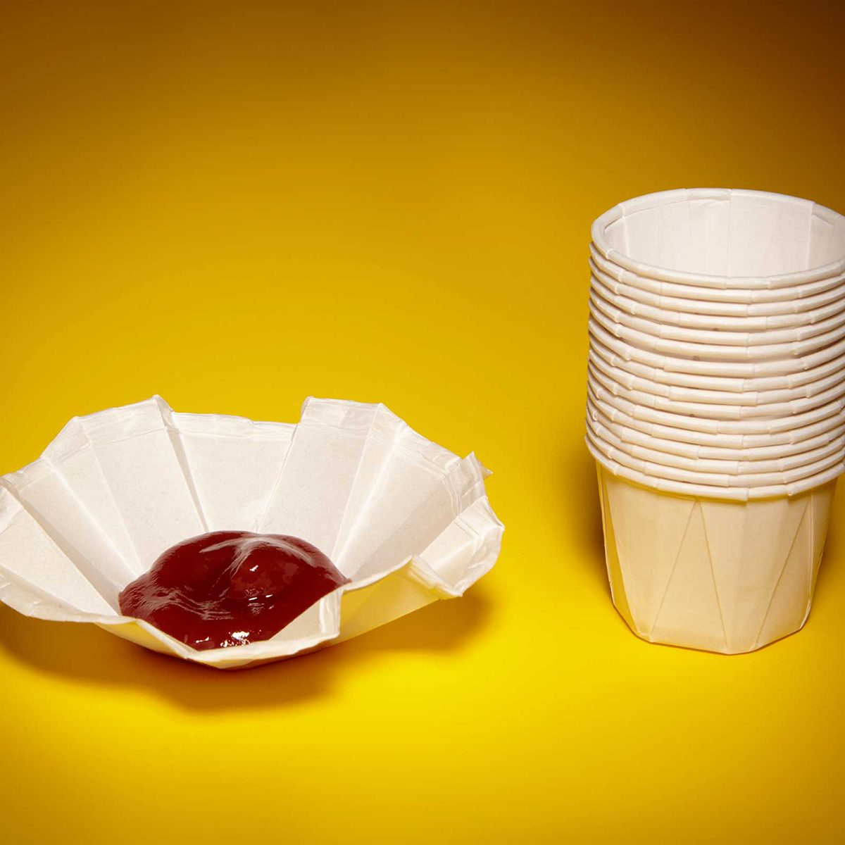 Unfolded ketchup cup