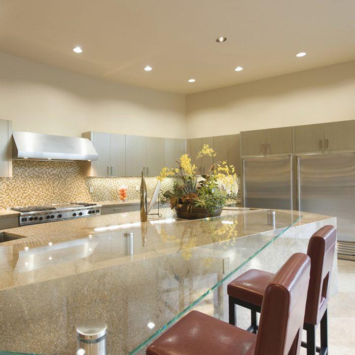 Glass topped breakfast table in modern kitchen