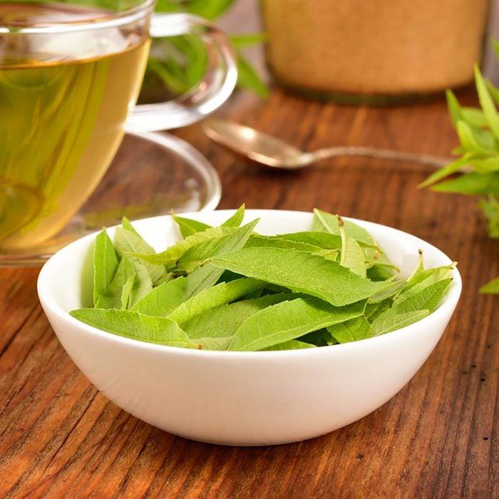 Lemon verbena leaves on white bowl and verbena tea on wooden table. Aloysia citrodora.; Shutterstock ID 323071469; Job (TFH, TOH, RD, BNB, CWM, CM): Taste of Home
