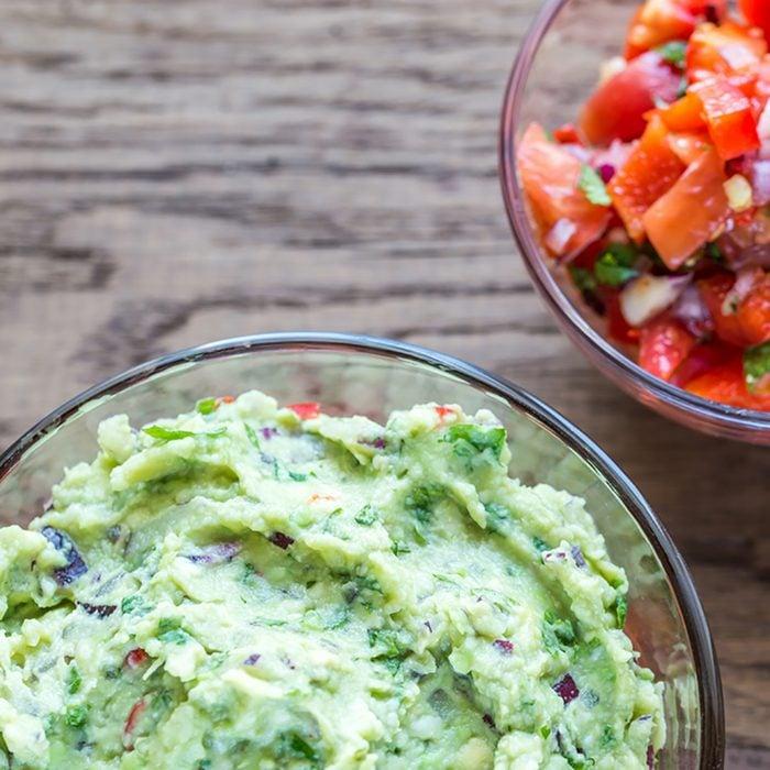 Bowls of guacamole and salsa; Shutterstock ID 349687460; Job (TFH, TOH, RD, BNB, CWM, CM): Taste of Home