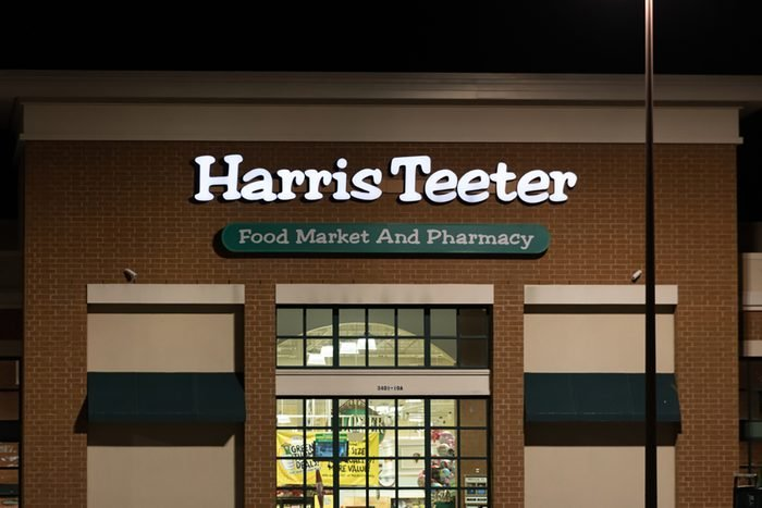 A Harris Teeter grocery shore is open at night.