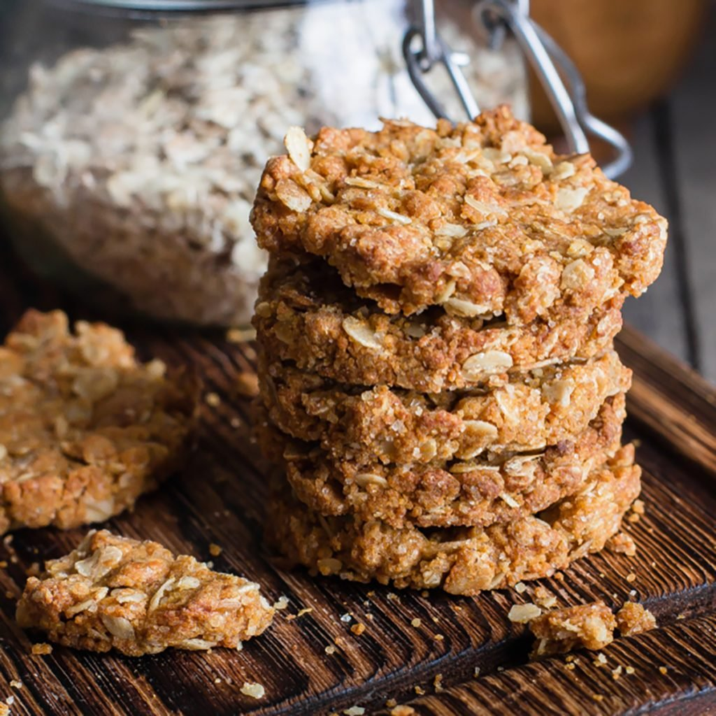 Homemade oatmeal cookies on wooden board on old table background. Healthy Food Snack Concept