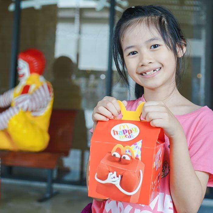 BANGKOK,THAILAND - MARCH 10,2018 :little Asian girl holding happy meal box at McDonald's restaurant; Shutterstock ID 1047090799; Job (TFH, TOH, RD, BNB, CWM, CM): Taste of Home