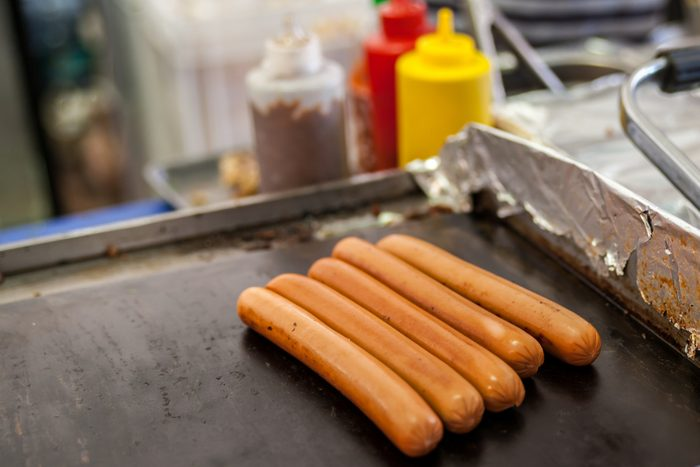 Sausages for hot dogs on the grill; Shutterstock ID 1080664781; Job (TFH, TOH, RD, BNB, CWM, CM): TOH Hot Dog Recall