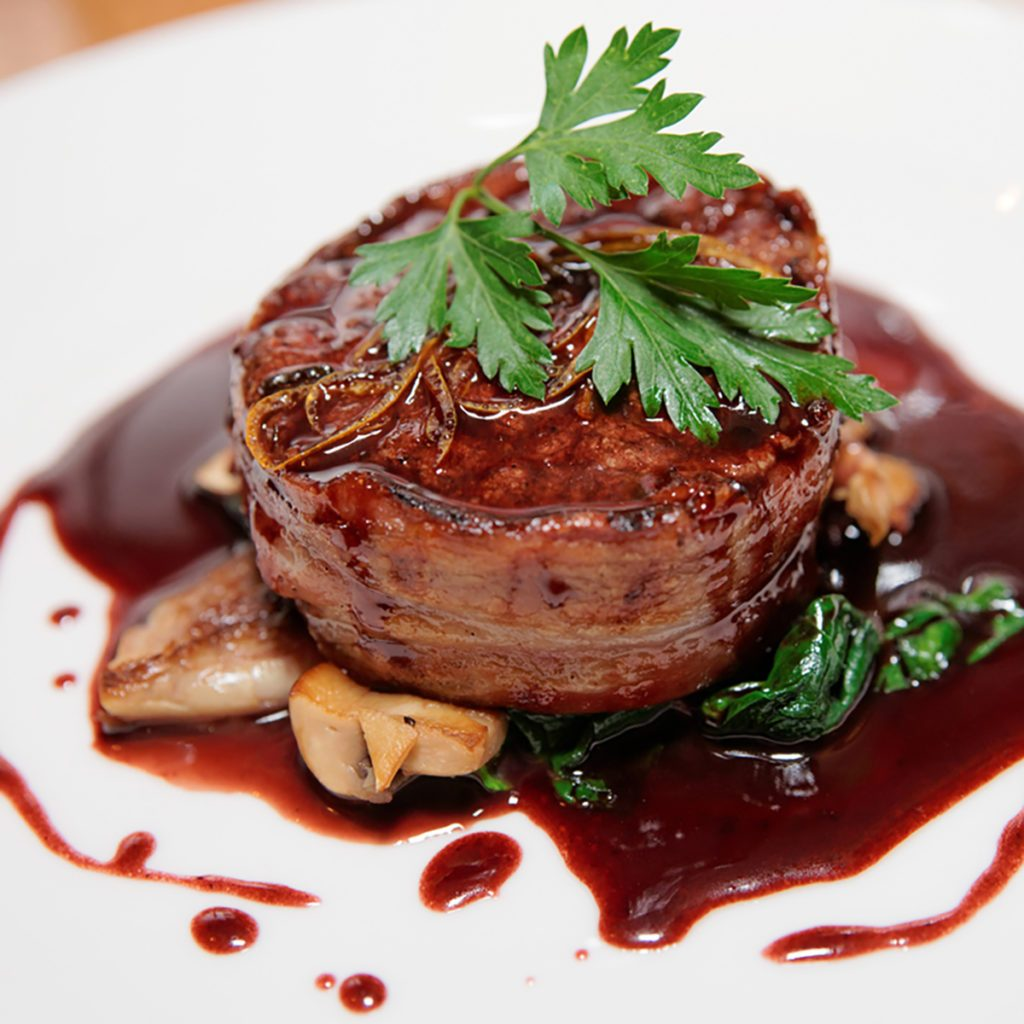 Tenderloin steak wrapped in bacon with demi-glace sauce