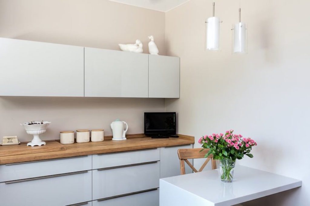 white kitchen cabinets and island with pink flowers