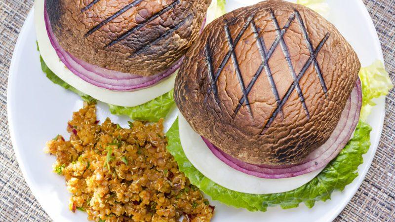 Grilled portabella vegetarian burger served with vegetables.
