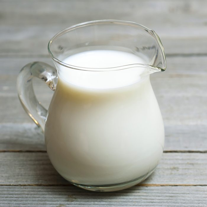 a jug of milk on wooden table;