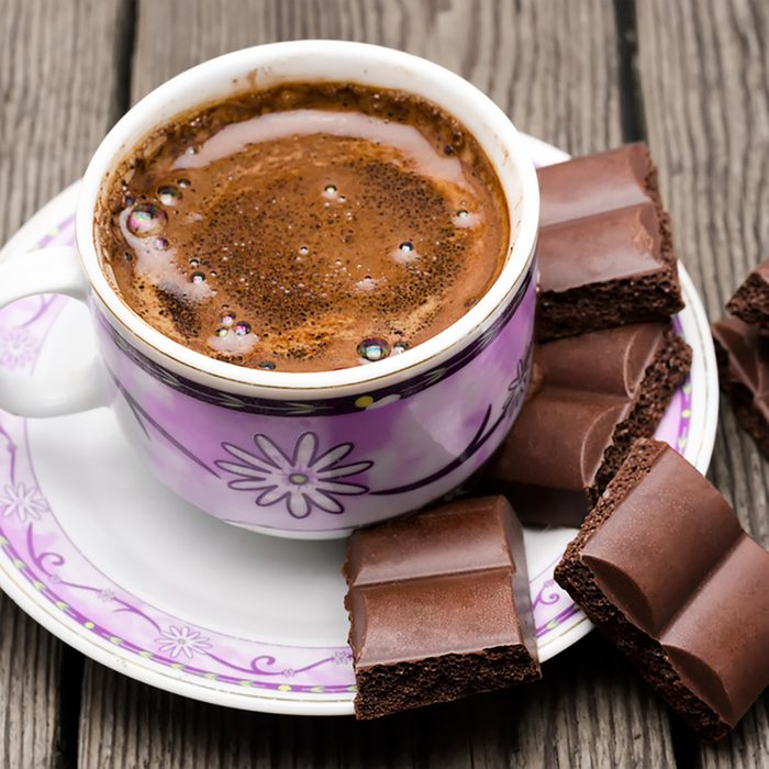cup of coffee with chocolate on a table