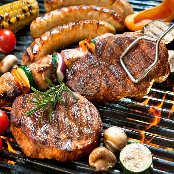 grilling safety Assorted delicious grilled meat with vegetables over the coals on barbecue