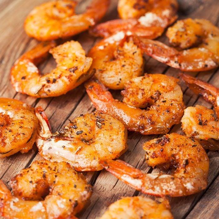 Shrimps fried on a wooden background