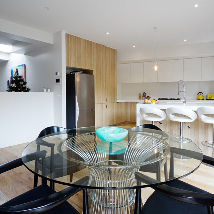 Kitchen with island bench and open plan dining area in modern australian home