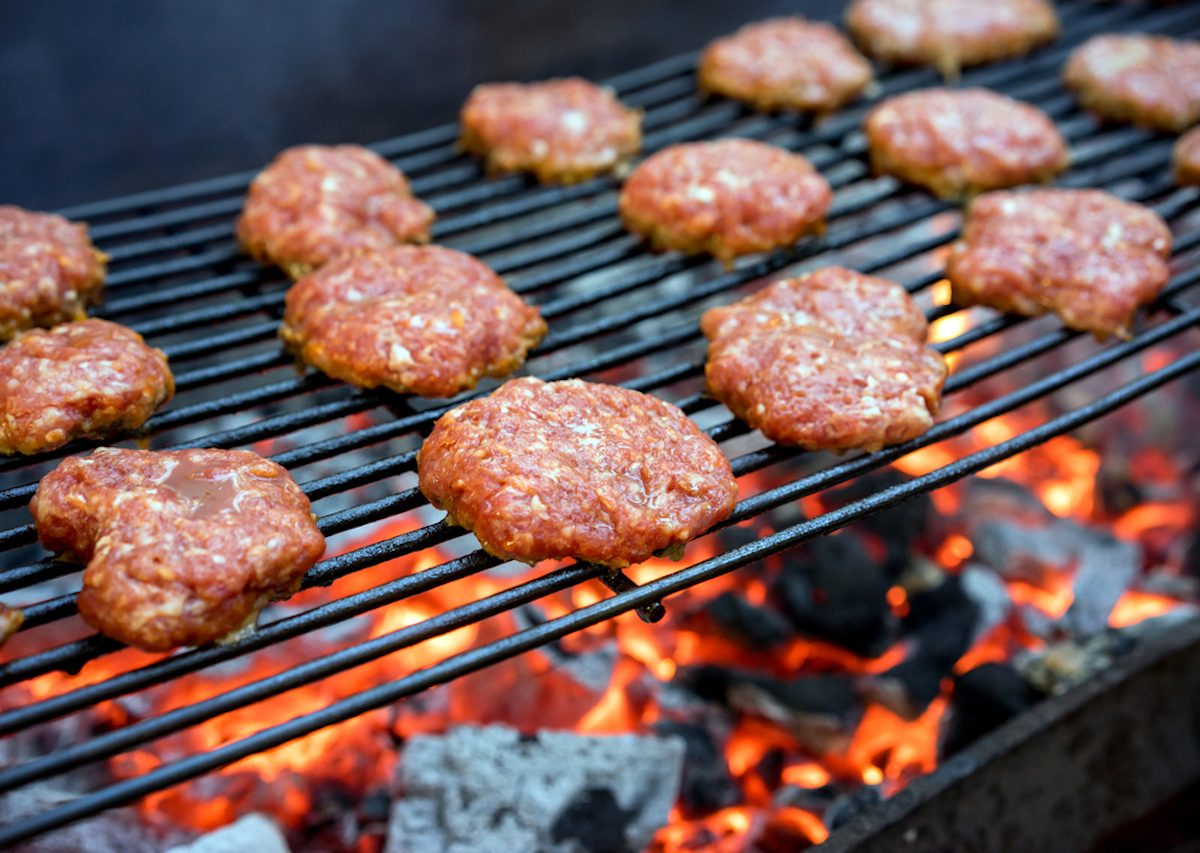 Grilled burgers on a barbecue grill close-up.